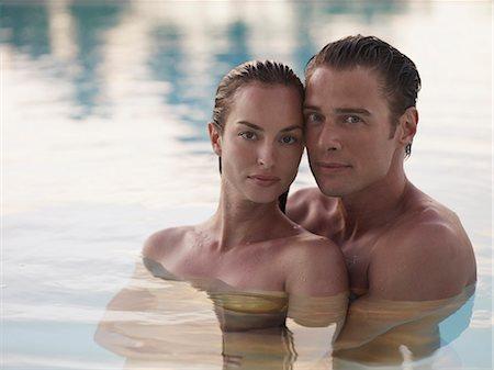 Couple hugging in swimming pool Stock Photo - Premium Royalty-Free, Code: 635-03441387
