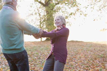 Senior couple holding hands outdoors in autumn Stock Photo - Premium Royalty-Free, Code: 635-03457313