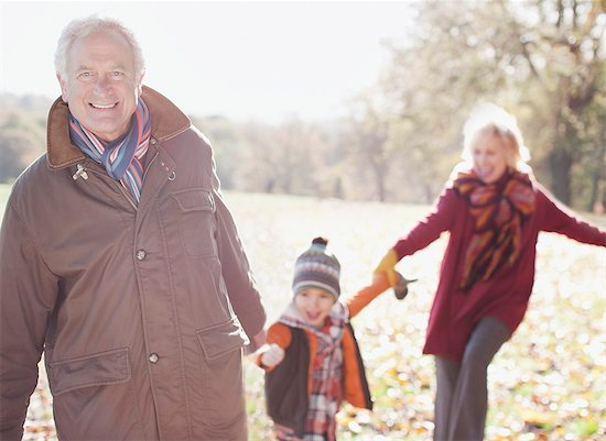 Grandparents playing in park with grandson Stock Photo - Premium Royalty-Free, Image code: 635-03457351
