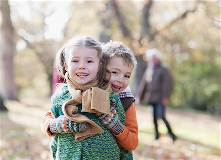 Brother and sister hugging outdoors Stock Photo - Premium Royalty-Free, Code: 635-03457360