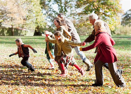 Extended family running in park Stock Photo - Premium Royalty-Free, Code: 635-03457361