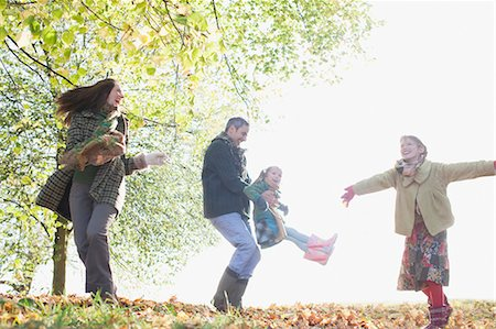 Family playing outdoors in autumn Stock Photo - Premium Royalty-Free, Code: 635-03457400