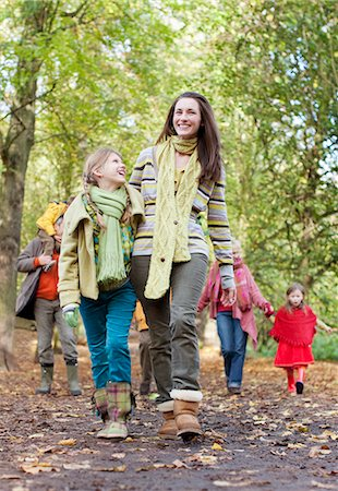 Family walking in park in autumn Stock Photo - Premium Royalty-Free, Code: 635-03457426