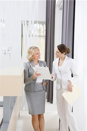 Businesswomen reviewing paperwork together Stock Photo - Premium Royalty-Free, Code: 635-03457786