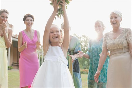 Girl catching bridal bouquet Stock Photo - Premium Royalty-Free, Code: 635-03515414