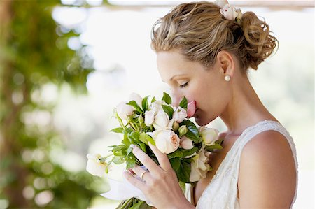 Bride smelling bouquet Stock Photo - Premium Royalty-Free, Code: 635-03515421