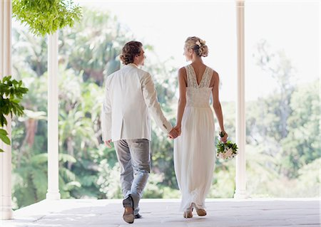 Bride and groom holding hands Stock Photo - Premium Royalty-Free, Code: 635-03515461