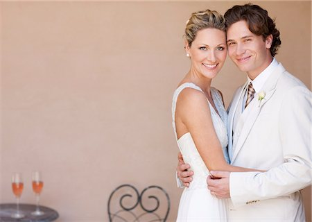Bride and groom hugging Stock Photo - Premium Royalty-Free, Code: 635-03515470