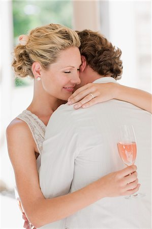 Bride and groom hugging Stock Photo - Premium Royalty-Free, Code: 635-03515471