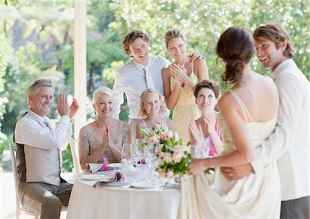 flower greeting - Family celebrating at wedding reception Stock Photo - Premium Royalty-Free, Code: 635-03515503