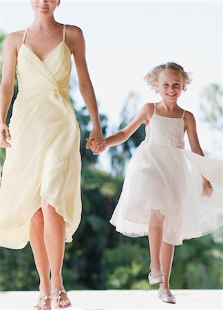 Flower girl holding hands with mother Stock Photo - Premium Royalty-Free, Code: 635-03515527