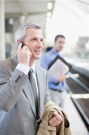 platform - Businessman talking on cell phone on train platform Stock Photo - Premium Royalty-Free, Code: 635-03515590