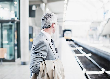 Businessman waiting for train on platform Stock Photo - Premium Royalty-Free, Code: 635-03515591