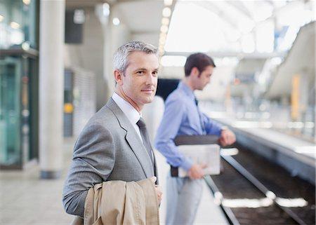 platform - Businessmen waiting for train on platform Stock Photo - Premium Royalty-Free, Code: 635-03515592