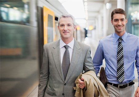 platform - Businessmen walking on train platform Stock Photo - Premium Royalty-Free, Code: 635-03515619