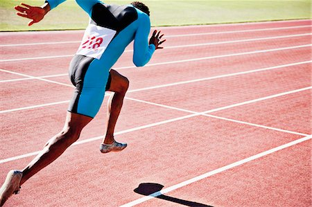sprint - Runner sprinting on track Stock Photo - Premium Royalty-Free, Code: 635-03515637