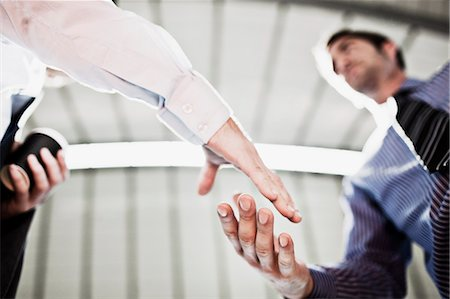 Businessmen shaking hands Stock Photo - Premium Royalty-Free, Code: 635-03515632