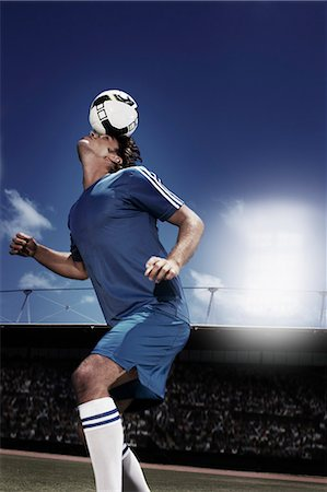 Soccer player heading soccer ball Stock Photo - Premium Royalty-Free, Code: 635-03515642