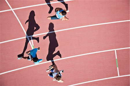 sprint - Runners competing on track Stock Photo - Premium Royalty-Free, Code: 635-03515664