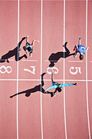 finish line - Runner crossing finishing line on track Stock Photo - Premium Royalty-Free, Code: 635-03515666