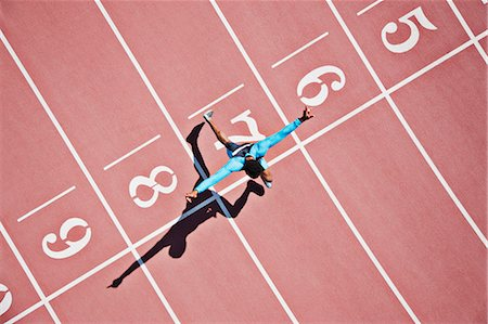 finish line - Runner crossing finishing line on track Stock Photo - Premium Royalty-Free, Code: 635-03515667