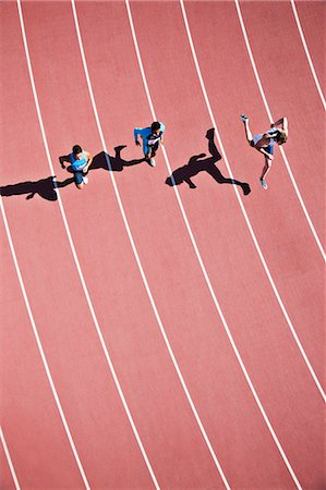 sprint - Runners competing on track Stock Photo - Premium Royalty-Free, Code: 635-03515663
