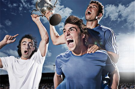 footballeur - Soccer players cheering with trophy Stock Photo - Premium Royalty-Free, Code: 635-03515672