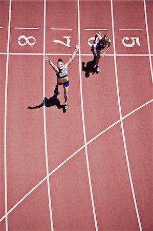 finish line - Winning runner cheering on track Stock Photo - Premium Royalty-Free, Code: 635-03515673