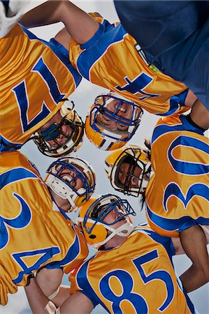 football team - Football players in huddle Stock Photo - Premium Royalty-Free, Code: 635-03515686