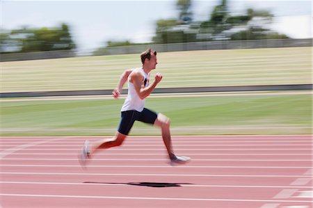 sprint - Runner sprinting on track Stock Photo - Premium Royalty-Free, Code: 635-03515687