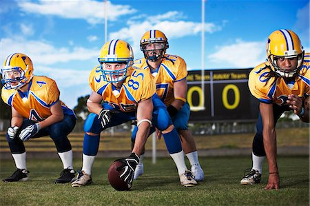 football team - Football players preparing to play football Stock Photo - Premium Royalty-Free, Code: 635-03515721