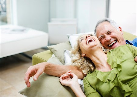 Couple laying on sofa together Stock Photo - Premium Royalty-Free, Code: 635-03515898