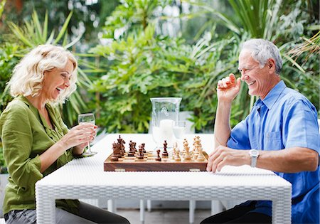 Couple playing chess outdoors Stock Photo - Premium Royalty-Free, Code: 635-03515899