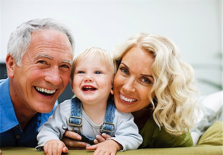 Grandparents enjoying grandson Stock Photo - Premium Royalty-Free, Code: 635-03515892