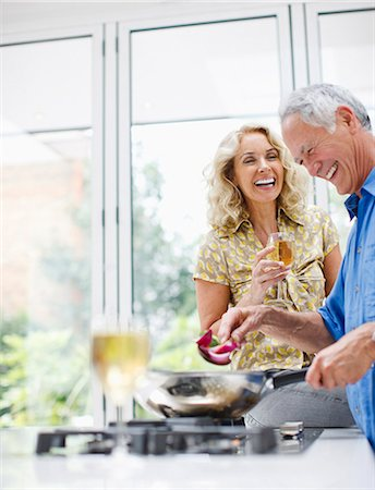 Couple cooking together Stock Photo - Premium Royalty-Free, Code: 635-03515913