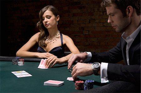 People playing poker in casino Stock Photo - Premium Royalty-Free, Code: 635-03515941
