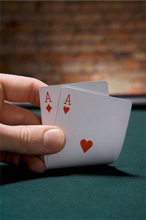 pair - Close up of pair of aces in casino Stock Photo - Premium Royalty-Free, Code: 635-03515943