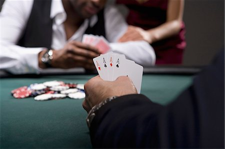 Man with four aces in casino Stock Photo - Premium Royalty-Free, Code: 635-03515968