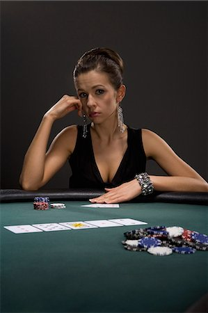 Woman playing cards in casino Stock Photo - Premium Royalty-Free, Code: 635-03515961