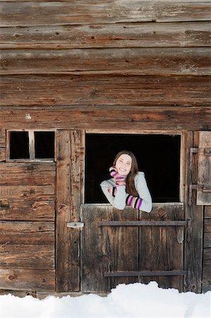 Woman standing at barn door Stock Photo - Premium Royalty-Free, Code: 635-03516022