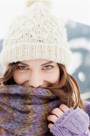 Woman in cap, scarf and gloves Stock Photo - Premium Royalty-Free, Code: 635-03516066