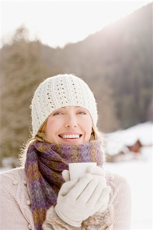 Woman drinking coffee outdoors in snow Stock Photo - Premium Royalty-Free, Code: 635-03516098