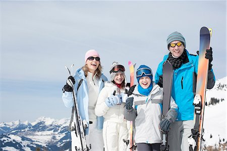 Family standing with skis Stock Photo - Premium Royalty-Free, Code: 635-03516090
