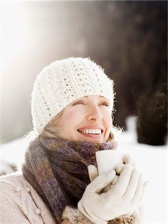 Woman drinking coffee outdoors in snow Stock Photo - Premium Royalty-Free, Code: 635-03516143