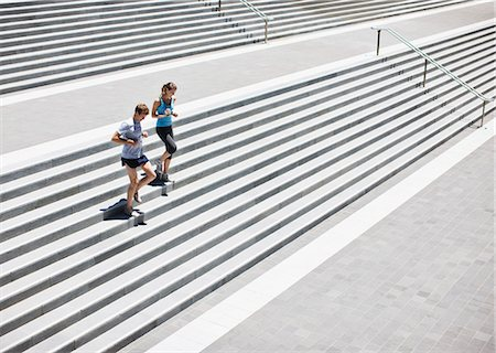 Runners running down stairs Stock Photo - Premium Royalty-Free, Code: 635-03516153