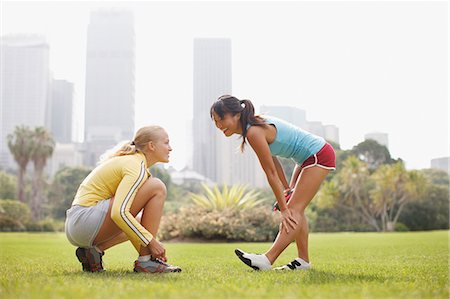 Friends preparing for exercise in park Stock Photo - Premium Royalty-Free, Code: 635-03516165