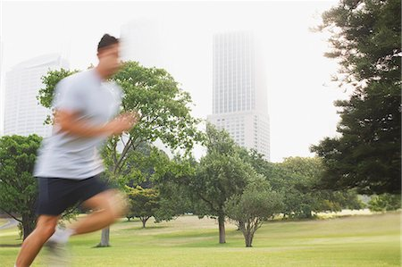 Man running in park Stock Photo - Premium Royalty-Free, Code: 635-03516217