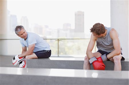 Boxer and coach resting after training Stock Photo - Premium Royalty-Free, Code: 635-03516253
