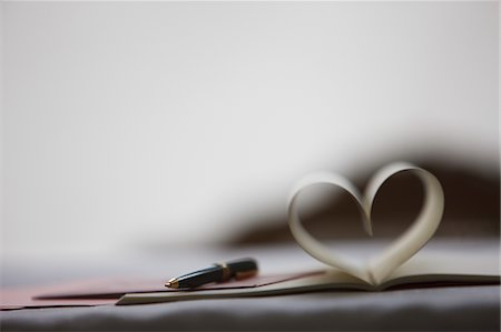 Pen and pages of notebook forming heart-shape Stock Photo - Premium Royalty-Free, Code: 635-03577442