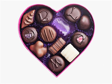 Close up of chocolates in heart-shape box Stock Photo - Premium Royalty-Free, Code: 635-03577456